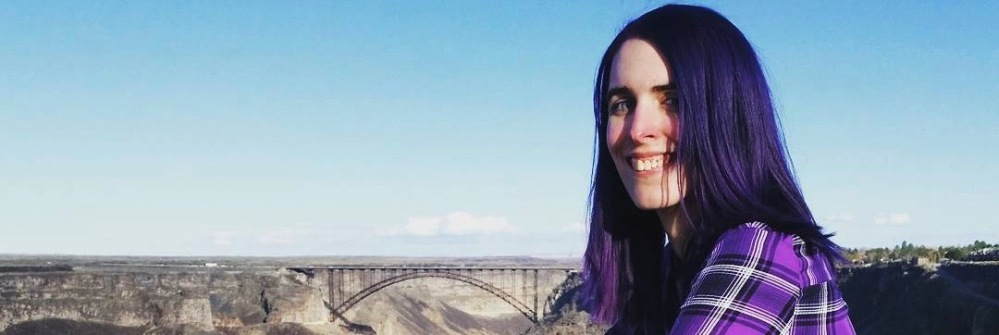 girl with purple hair and purple plaid shirt