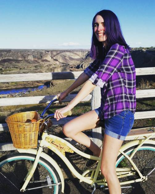 girl with purple hair on bicycle