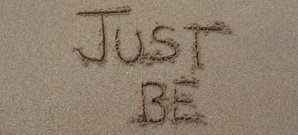 """""""Just Be"""" drawn in sand"""