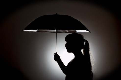 woman holding umbrella in the light